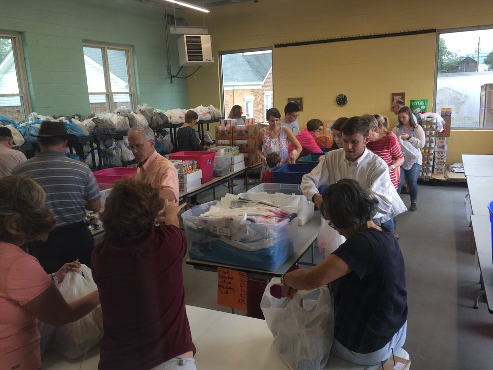 A recent packing inside our new HOPE Packs section of the Open Door Cafe building. We are packing 800 bags for delivery each Friday to food insecure students in 17 different schools in Wythe and Bland counties.