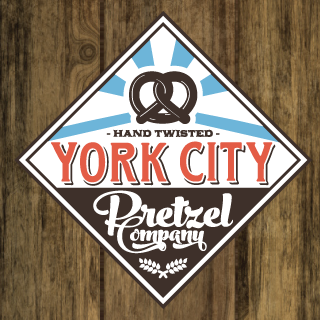 YORK CITY PRETZEL COMPANY   39 W. Market Street York, PA 17401   yorkcitypretzelcompany.com  These hand-twisted, small batch pretzels have been gracing the dining scene in downtown York since 2014, and we wouldn't have it any other way. You can find them at their store on W. Market Street, where they bake every pretzel the Bavarian way, or in a variety of other local restaurant dishes. These aren't your grandma's pretzels, they're much better (just don't tell her)!