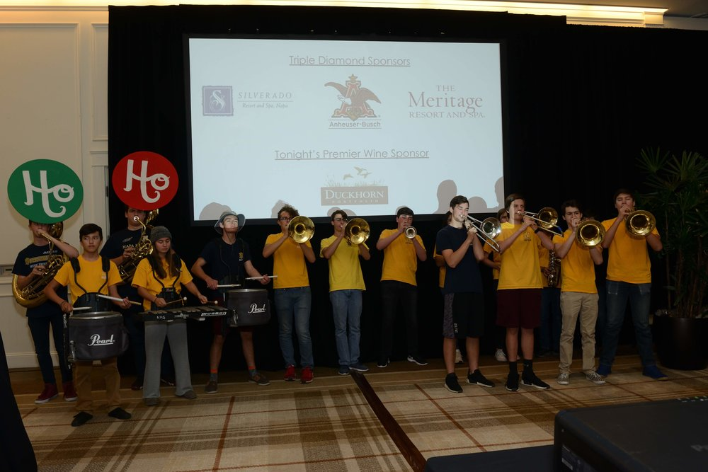 Napa High Pep Band cheering on live auction winners at the Senator Bill Dodd Holiday Party. Photo by Art and Clarity.