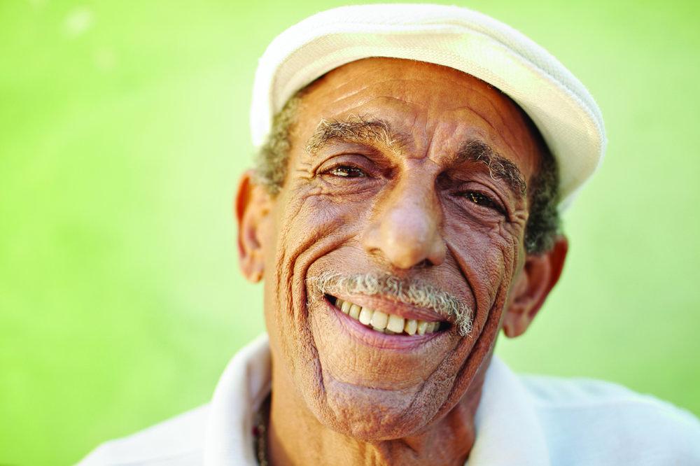 aged latino man smiling at camera
