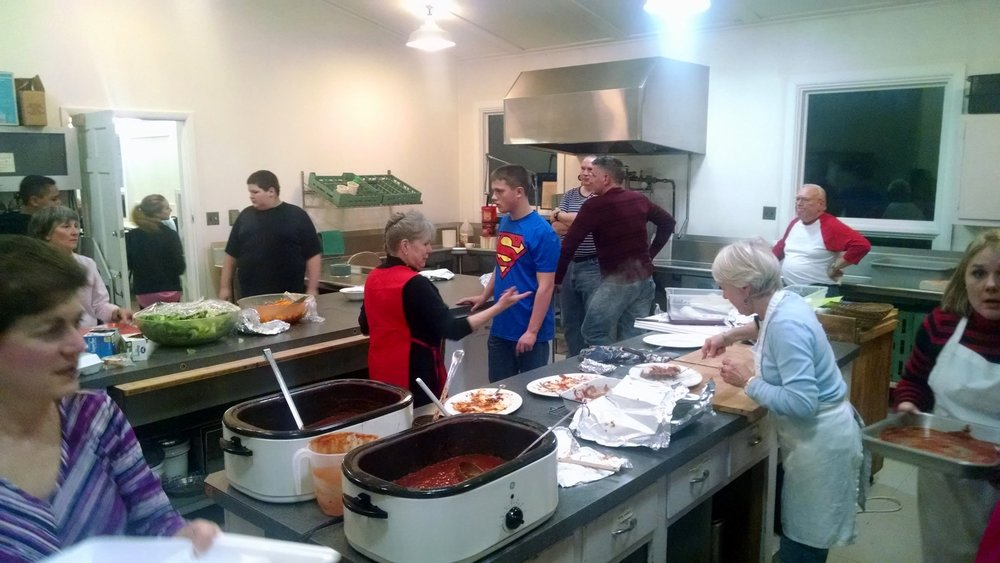 A big part of the fun of church dinners happens in the kitchen. - ERC serves dinners throughout the year.