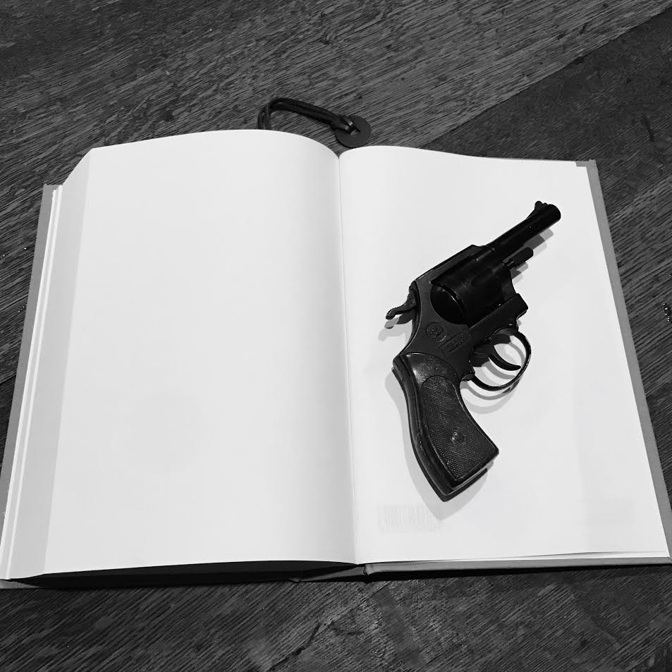 book with gun