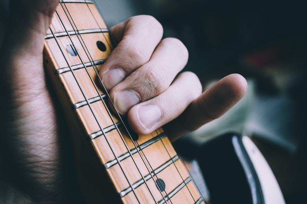 blur-bowed-stringed-instrument-close-up-1029411.jpg