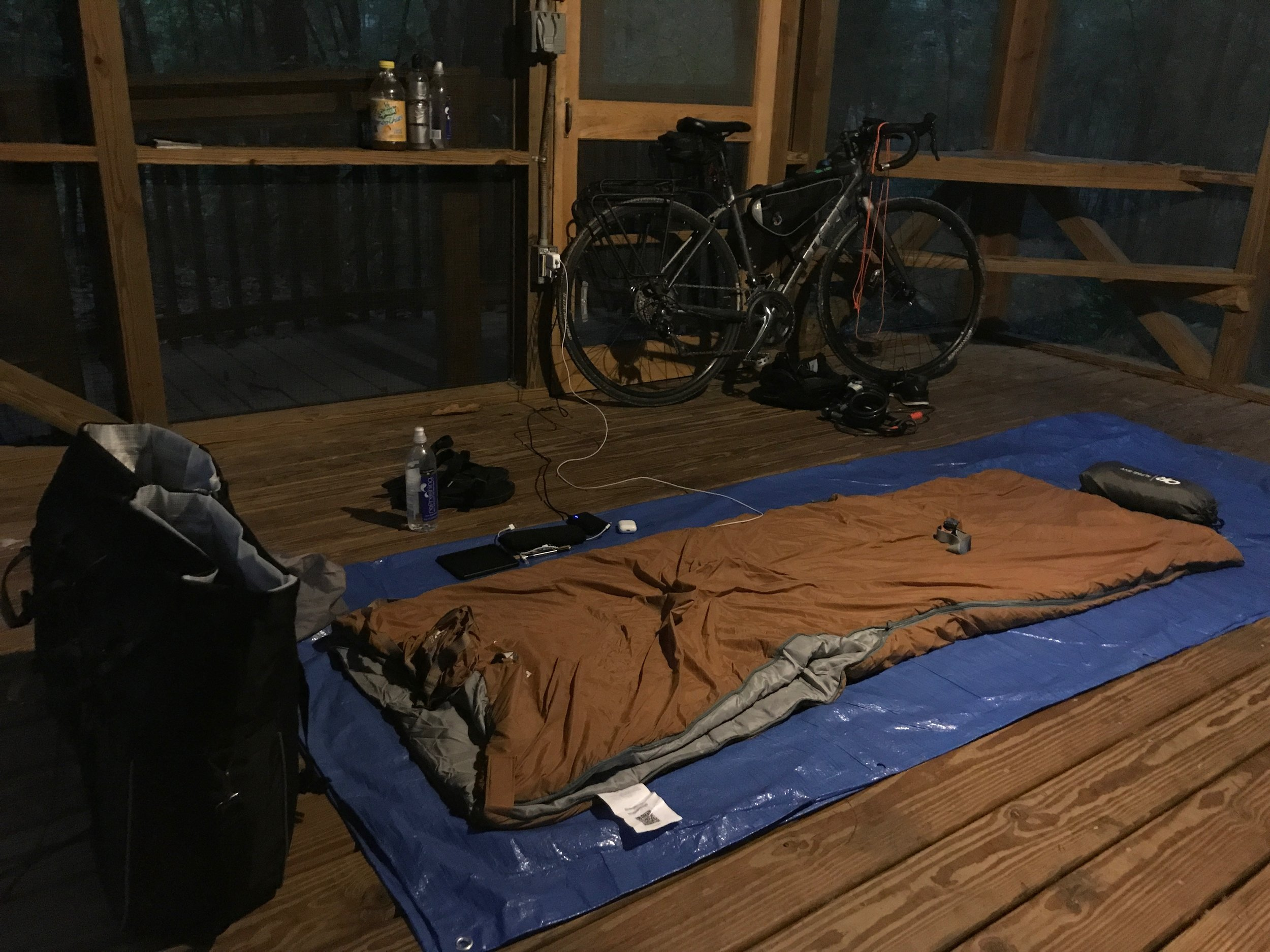 Sleeping bag in the Holton Creek River Camp platform - the wood floors were even well-sealed, but I set up the tarp as a barrier anyway.