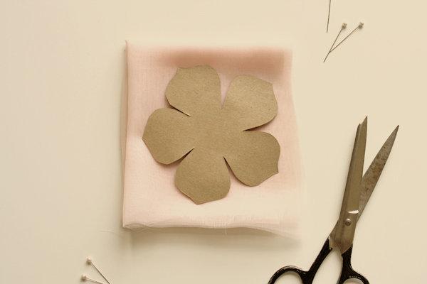 A flower made of paper and a scissor