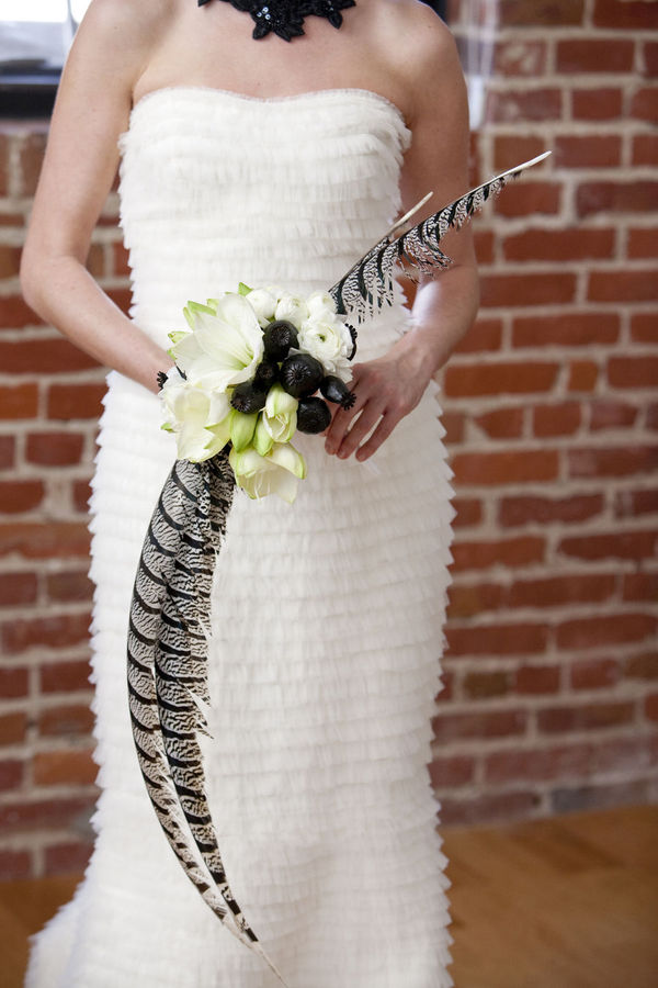 a woman with a black-white-feather-wedding-bouquet