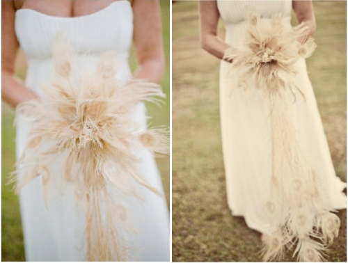 bride holding a feather bouquet