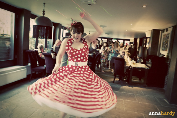 bride spinning while she's wearing a red-white-polka-dot-dress