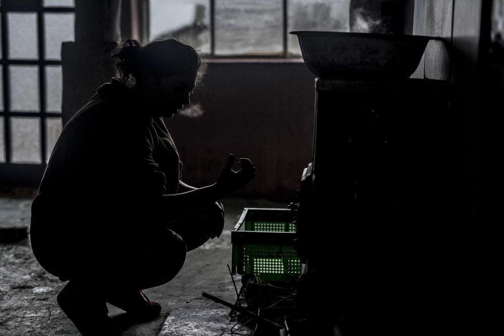 Viki heating bathwater in their frosty kitchen