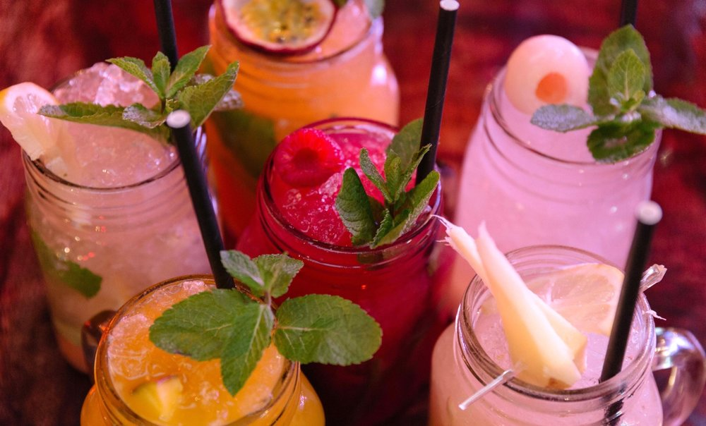 Centre: Raspberry Lemonade; clockwise from top centre: Passionfruit, Lychee, Ginger, Mango, and Classic Lemonades / Photo by Greg Purcell