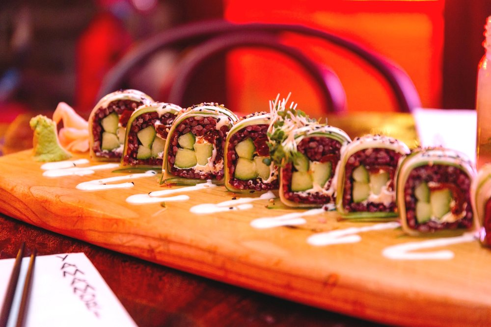 Cucumber Dragon Roll with black rice and wasabi mayonnaise