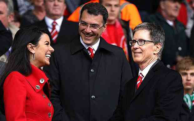 Damien Comolli (above with John Henry and wife Linda) was appointed Director of Football