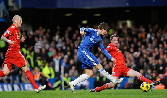 Coincidentally we played and beat Chelsea in Torres' first game. His best chance was blocked by Jamie Carragher (below