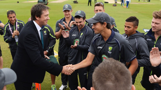 Ashton Agar receiving his Baggy Green from bowling legend, Glenn McGrath