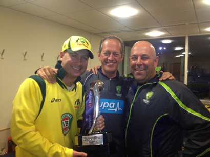 With the coach, captain and the trophy