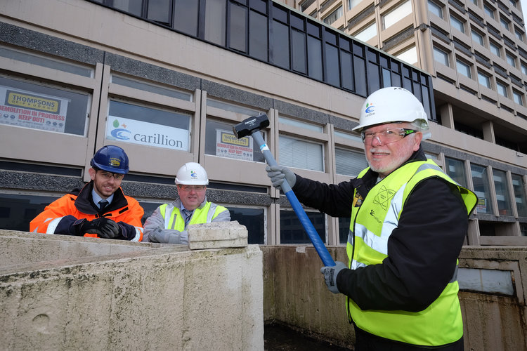 Photo caption: (left to right) Ben Harris (Thompsons) and Steve Hunter (Carillion), look on as David Glencorse starts the demolition of Milburngate House