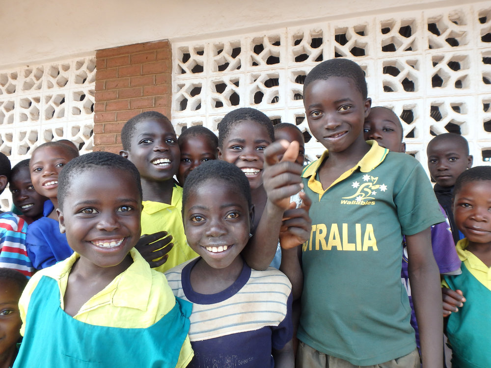 Kids in Malawi In Front of Completed School.JPG