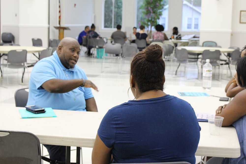 Photo:  Juan Nelson, StepUp Durham Employment Counselor and Community Outreach Coordinator, teaches the Choices, Decisions, and Consequences (CDC) module for Personal Development