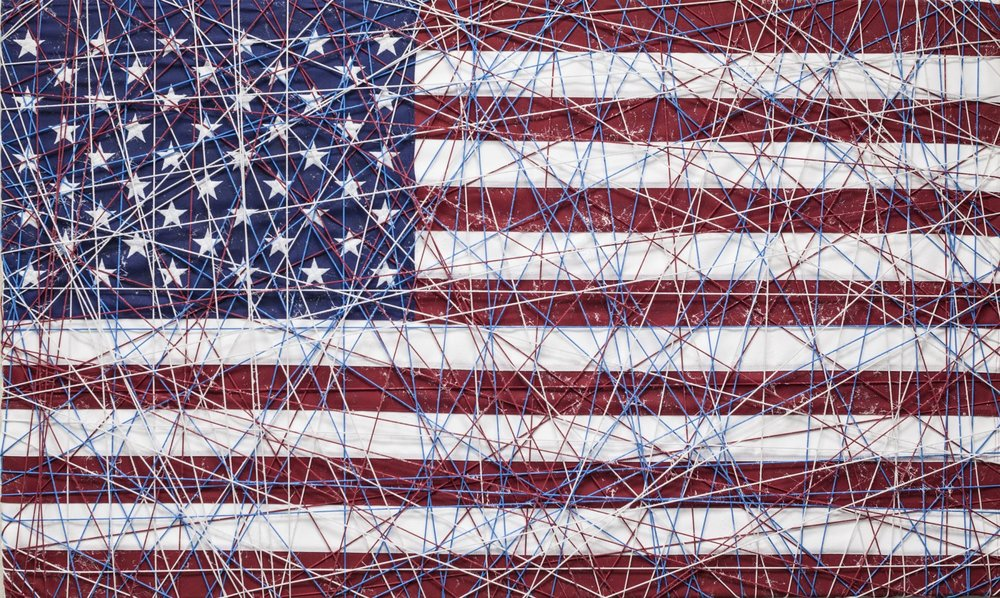 "Sleeping Beauty IV, 2018. Mixed media over American flag with threading. 36 x 60""."