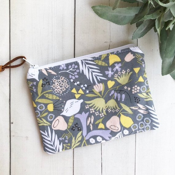 An adorable floral coin purse to coordinate with her key fob and keep her change (or ear buds) handy. Photo courtesy of MadebyKristyC