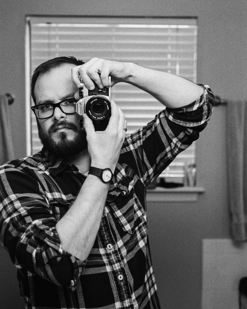 Self-portrait, Nikon FM, Kodak Tri-X 400 at 1600, developed in 1:50 Rodinal