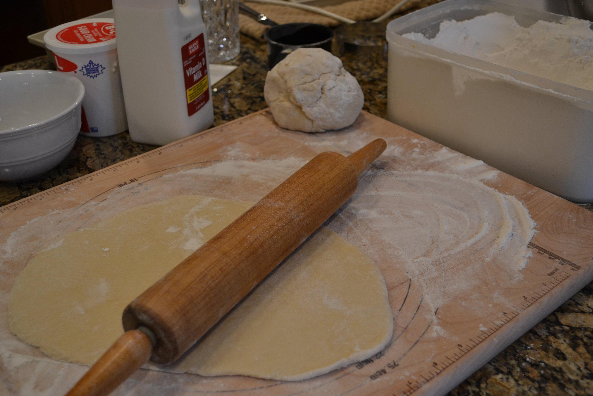rolling out pierogi dough