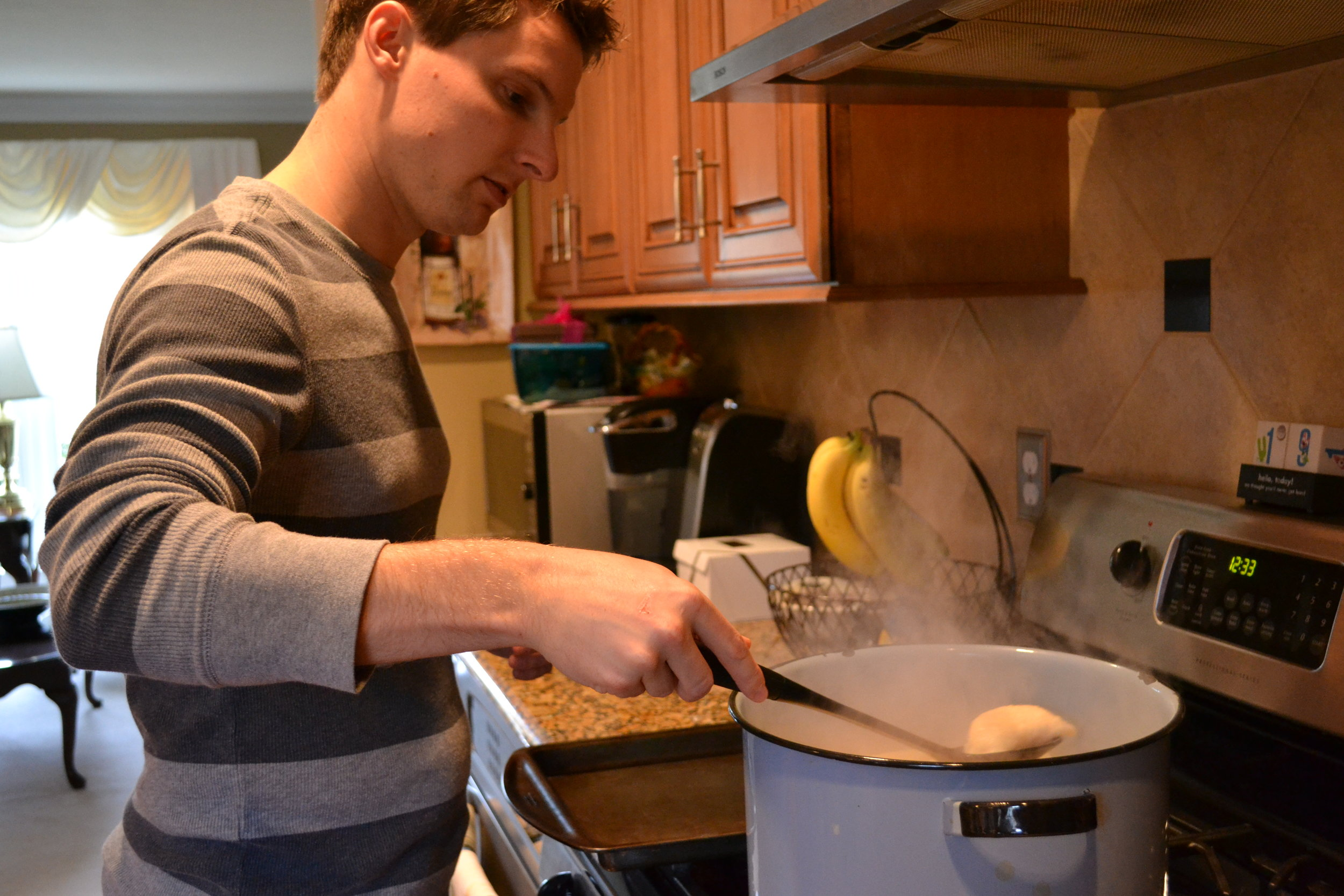 the fiance pulling pierogis out of the pot