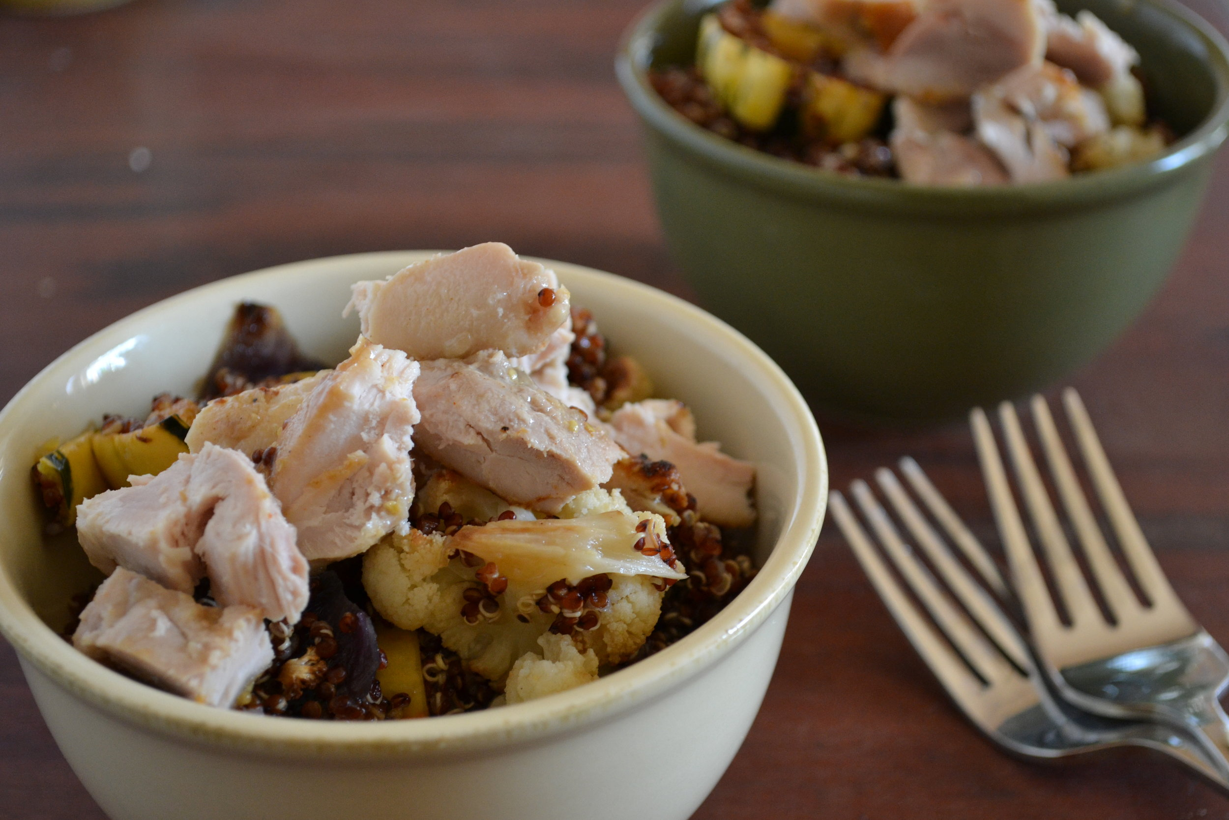 a bowl of red quinoa & veggies with chicken