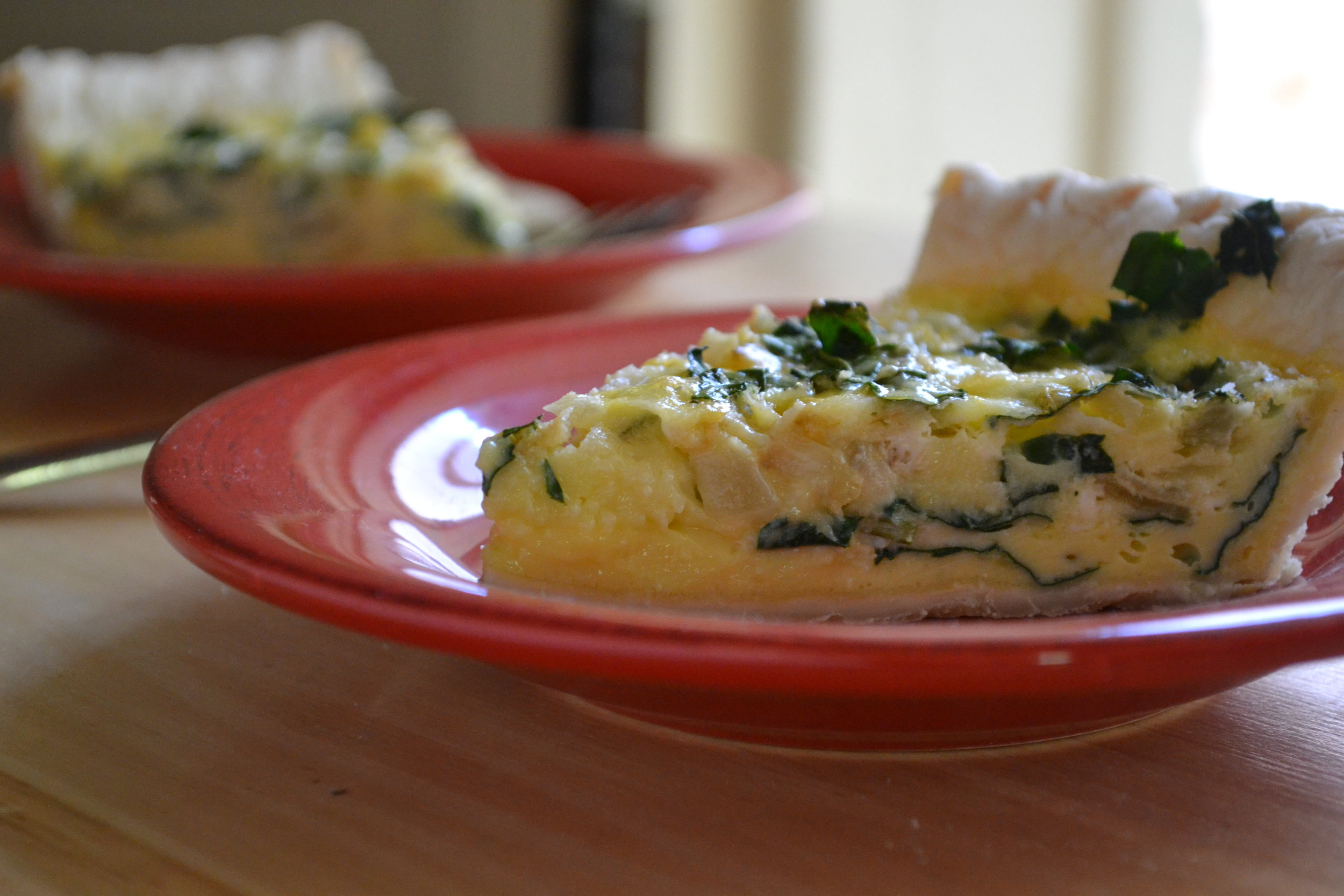 slices of kale and rosemary quiche