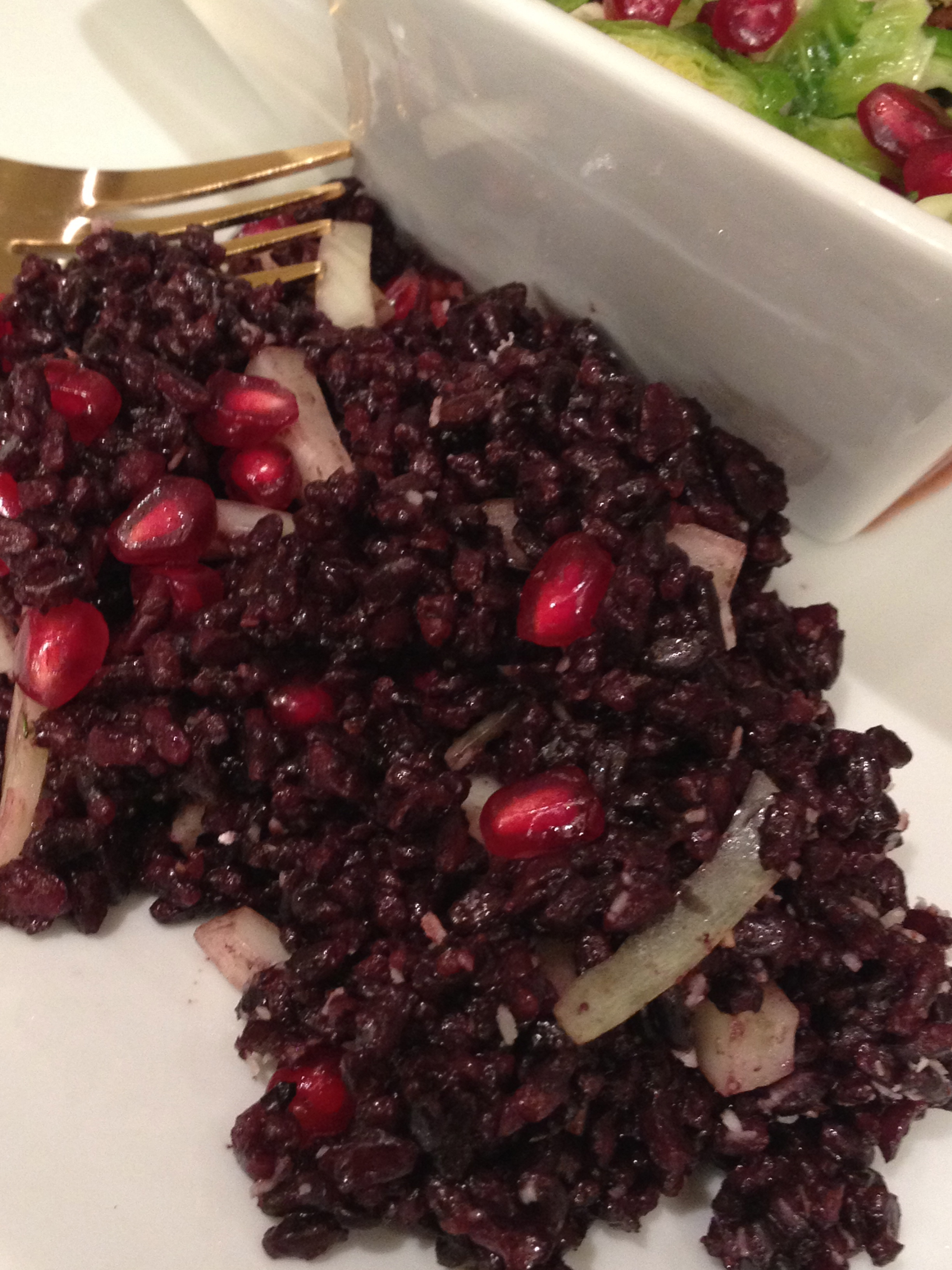 black rice and pomegranate seeds