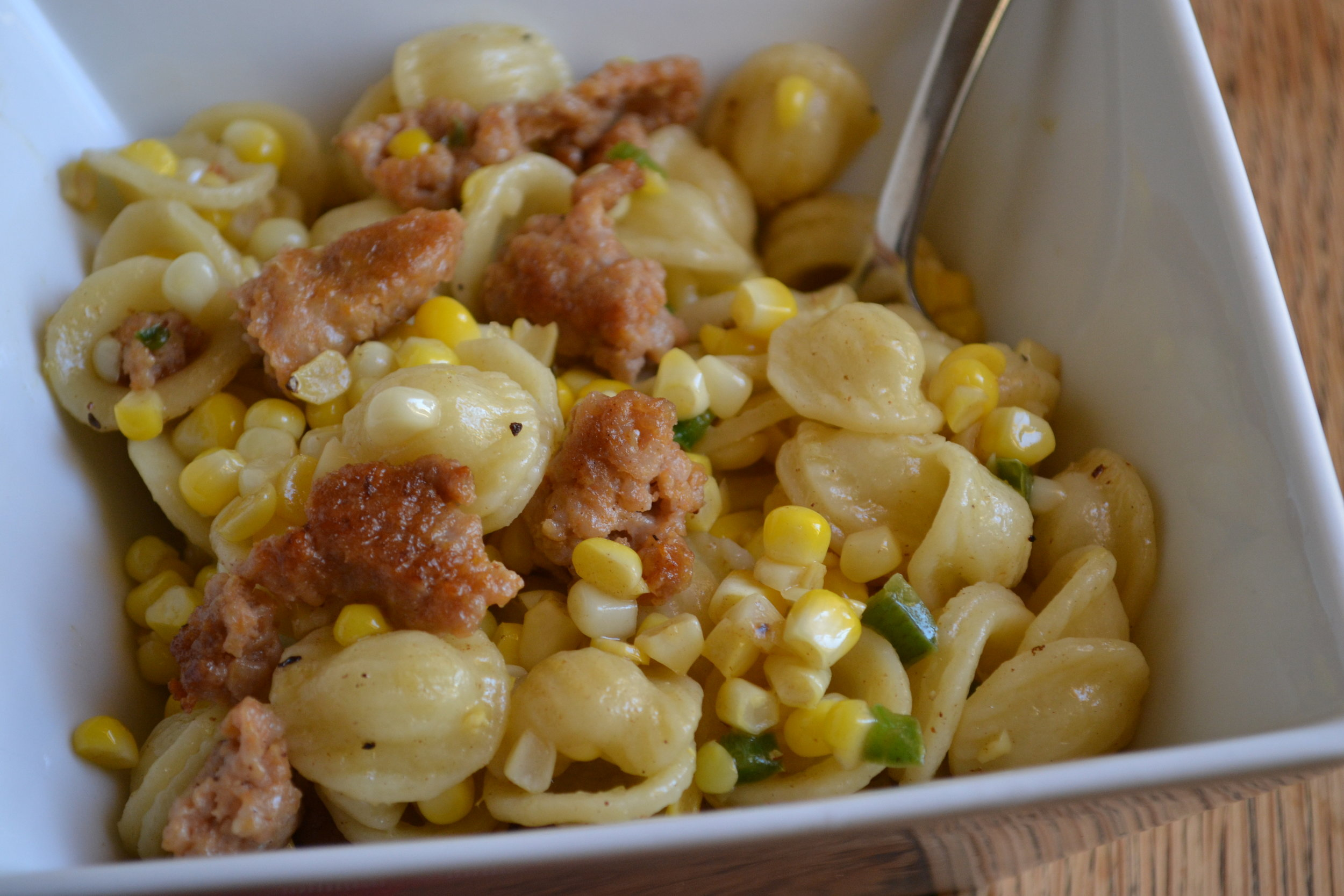 Bowl of Orecchiette with sausage, corn and chiles