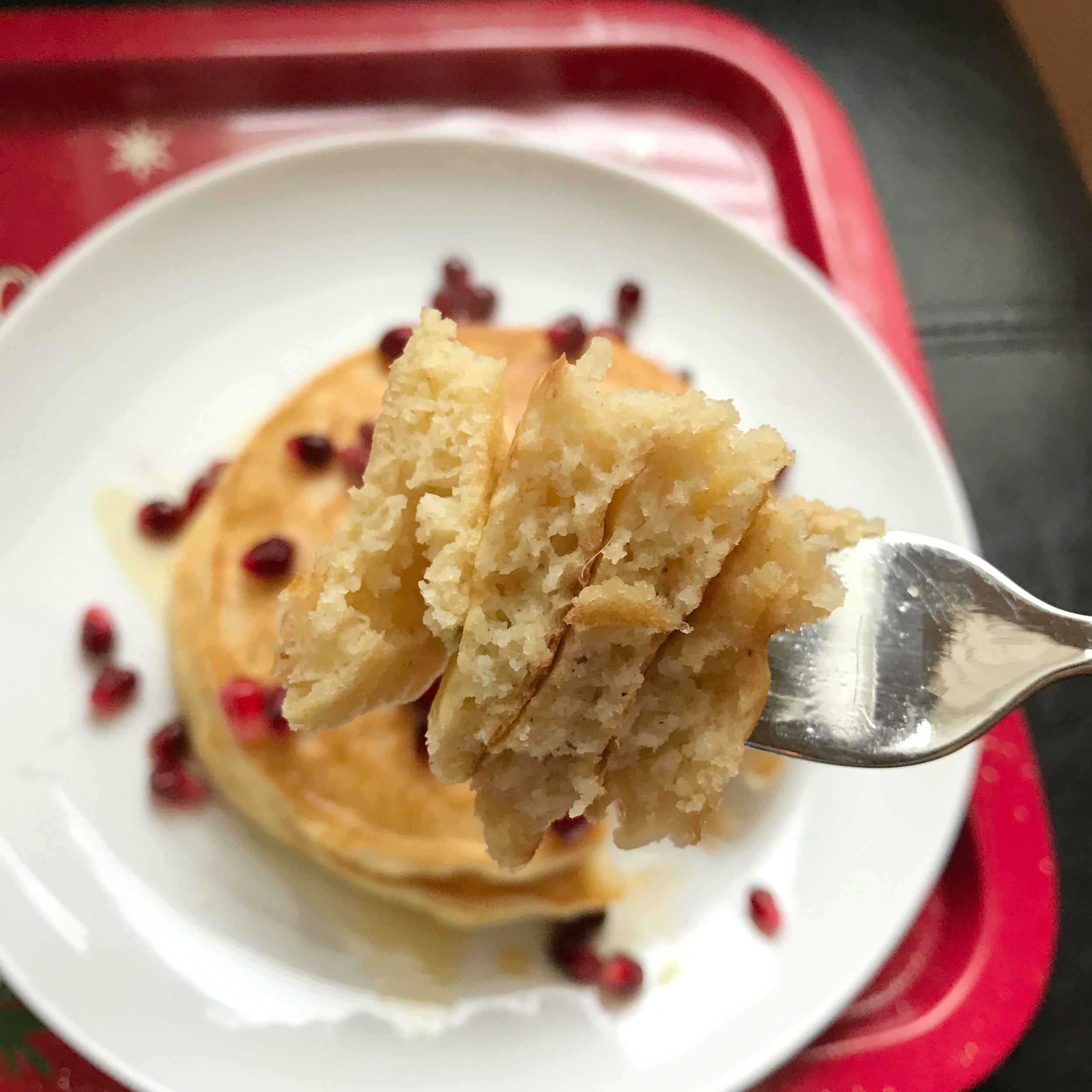 Fluffy bite of eggnog pancakes stack