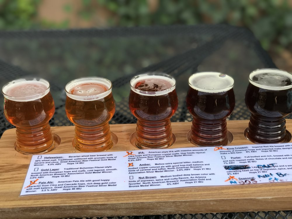 Daddy-to-be activity, Oak Creek Brewing Co tasting flight | Sedona Babymoon Itinerary | BySarahRae.com
