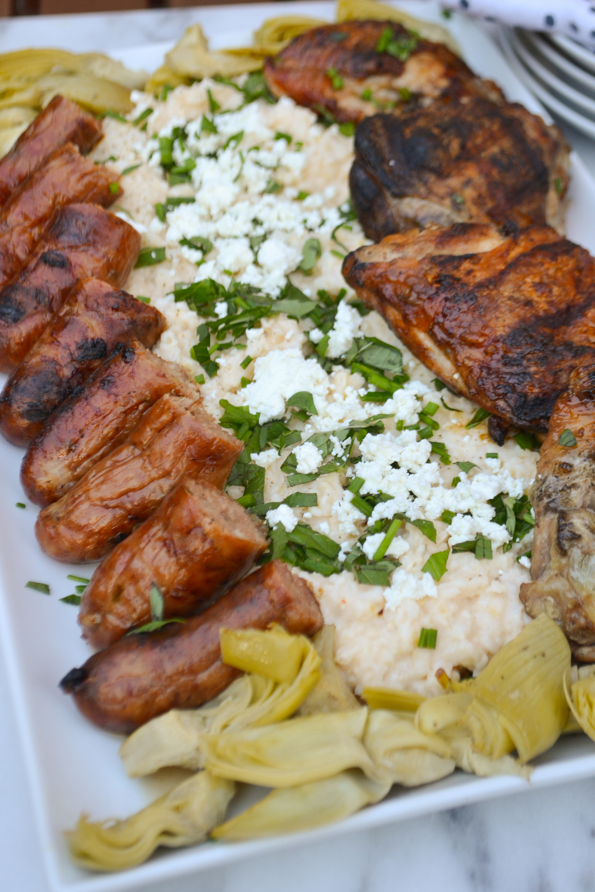 Grilled Chicken Thighs, Sausage Goat Cheese Grits Dinner