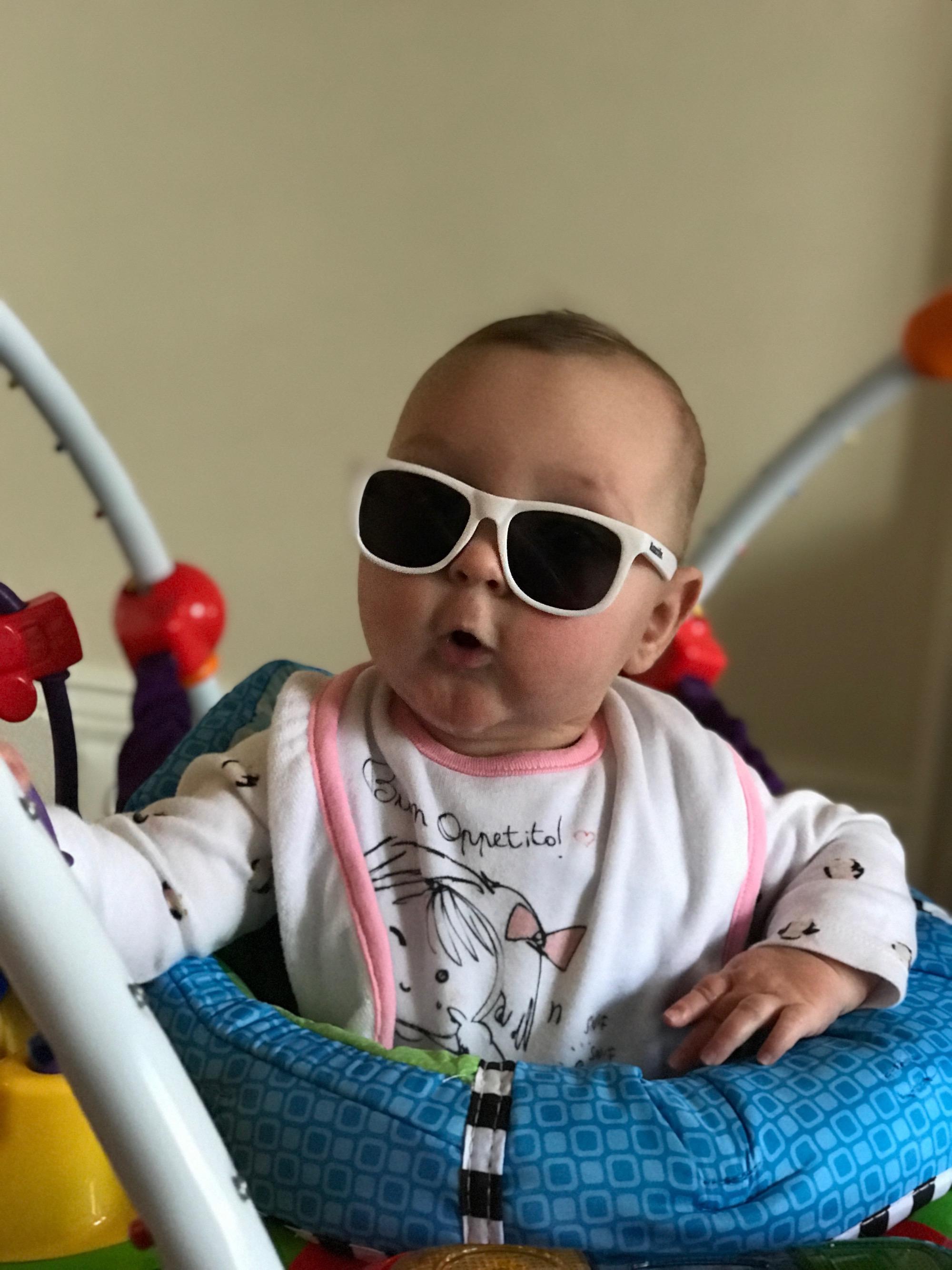 Atti wearing white sunglasses