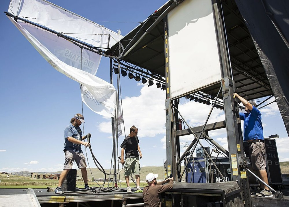 Crews build a stage used by Los Lonely Boys for one of the Park City Institute's St. Regis Big Stars, Bright Nights concerts last July at the Quinn's Junction recreation field. Park City Institute is asking the public for donations so it can continue to present performing artists and speakers to local audiences.