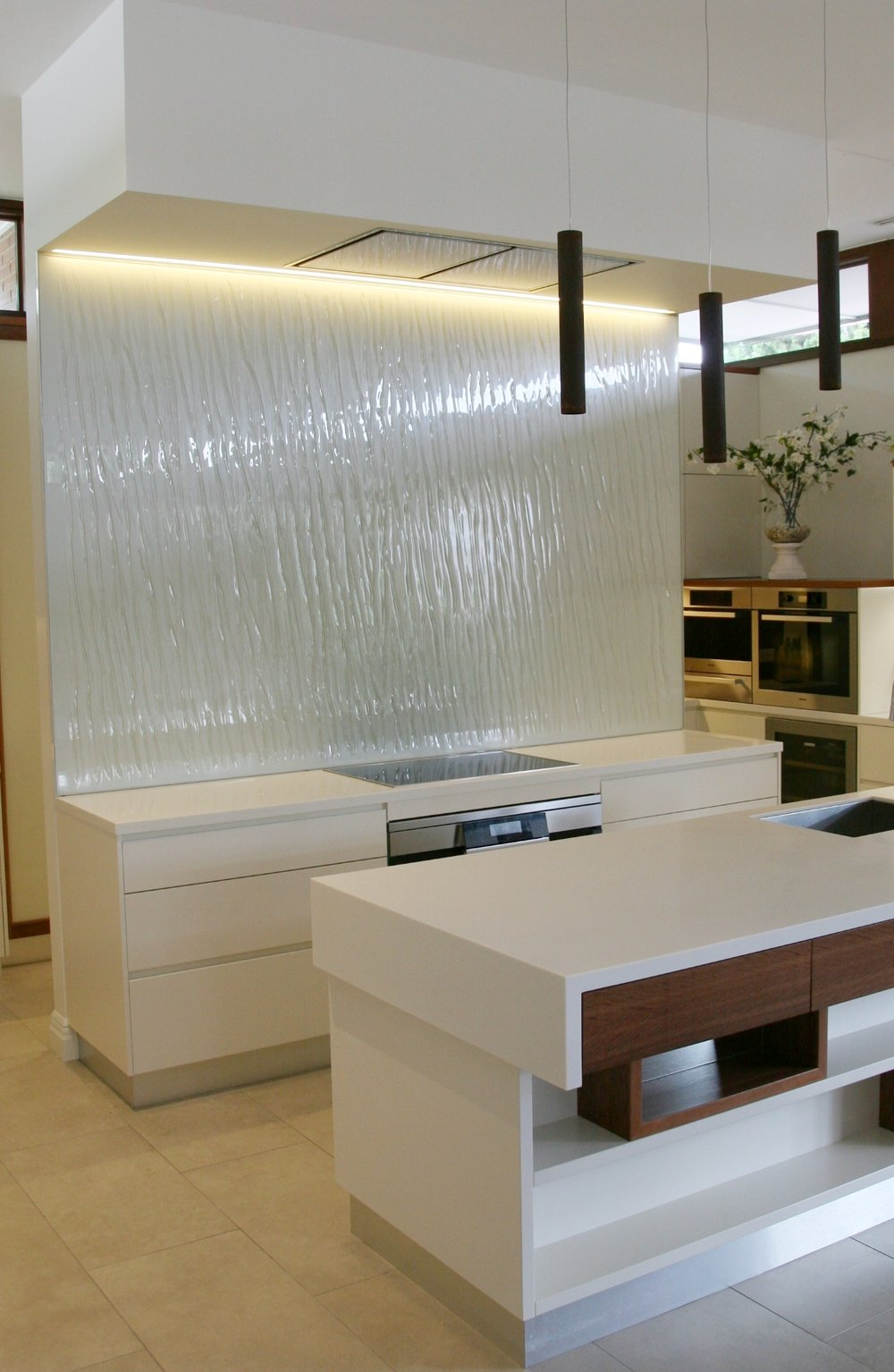 Custom slumped glass splashback feature wall
