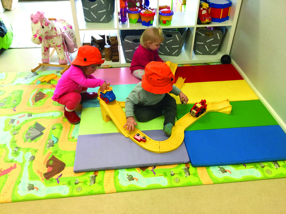 Toddlers playing with trucks