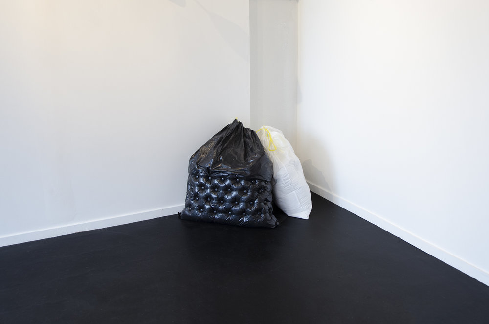 "Madison Donnelly     Trash Bags     Trash bags, upholstery foam, upholstery buttons    36""x24""x26"",    2018"