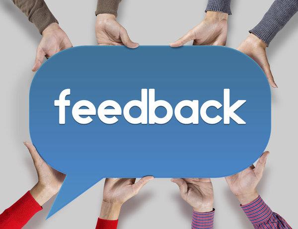 Group of friends showing feedback on speech bubble