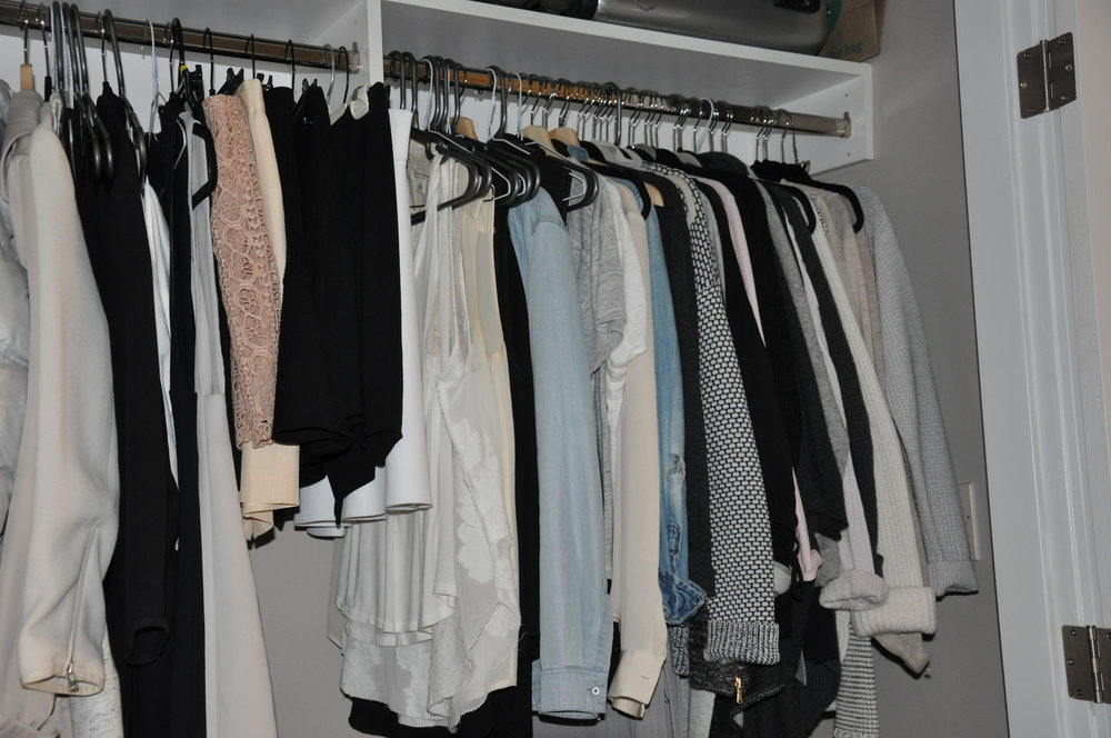 On the right side of my closet, I keep all my tops. From the center, it starts with the tank tops, moves to t-shirts and then to sweaters.