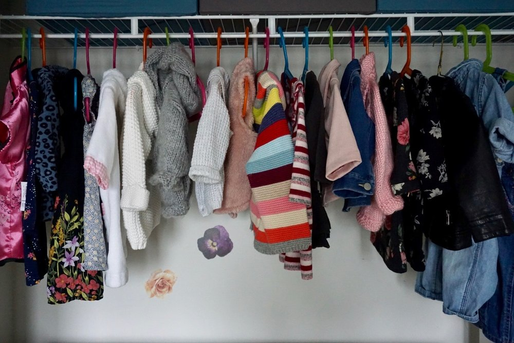 The top part of Nora's closet is where we hang her jackets, knitted sweaters, cardigans, dresses and overalls. This consists of things that currently fit, items Nora commonly wears when we go out, or cute items that look nice on display.