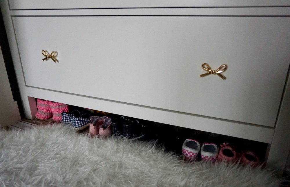 I keep Nora's shoes underneath her dresser!