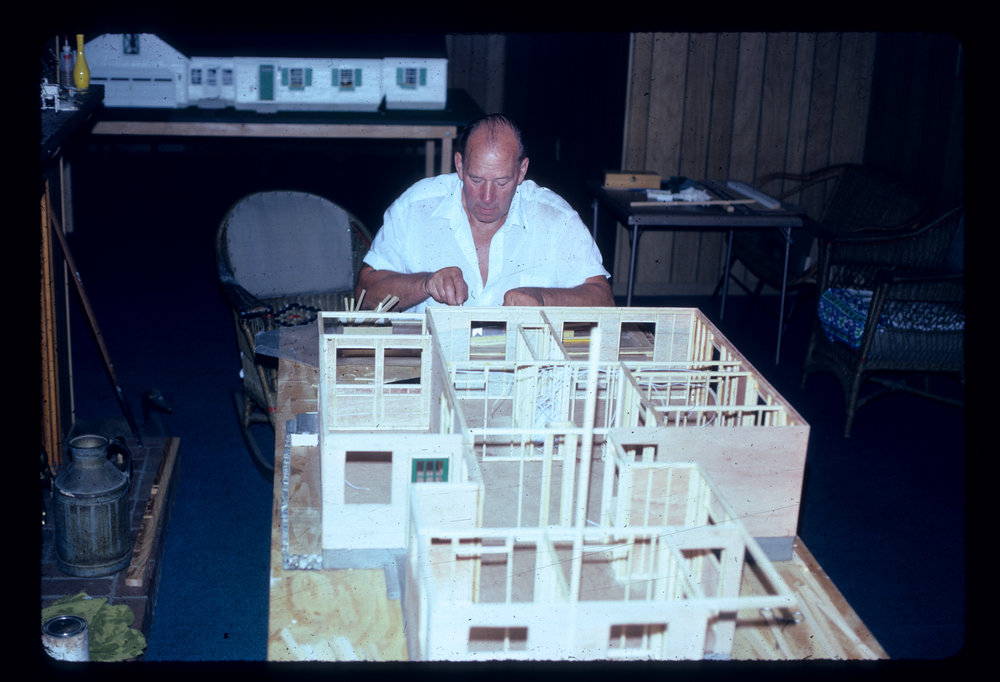 - Gene Martin works on a miniature replica of the Victorian farm house where his wife, Janet, grew up on Cottage Street in Natick. In the background is Martin's miniature replica of the home he and Janet built in 1955 to raise their three children. The 1955 replica is on display in the Natick History Museum.