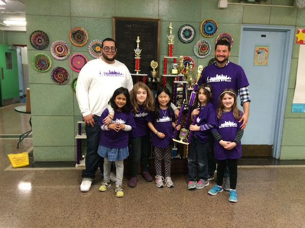 Coach Russell Makofsky, left, and coach Angel Lopez, right, with the 2016 PS 33's girls' chess team (missing 2 players).