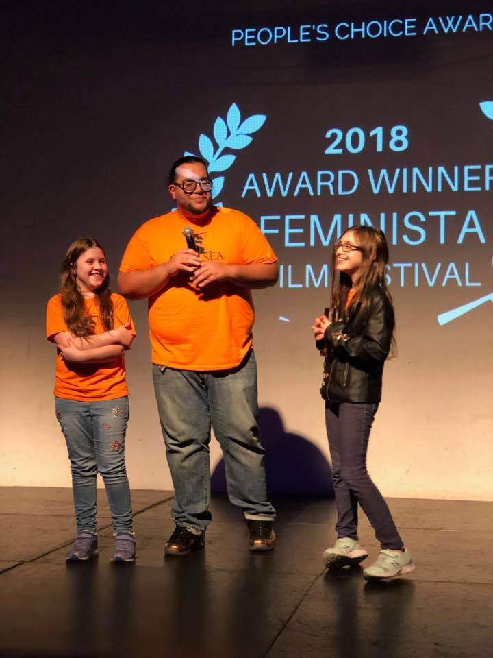 Accepting the People's Choice Award for filmmaker Ian Phillips are Coach Angel Lopez, Simone and Rose from the PS 33 Chelsea Prep Girls' Team.