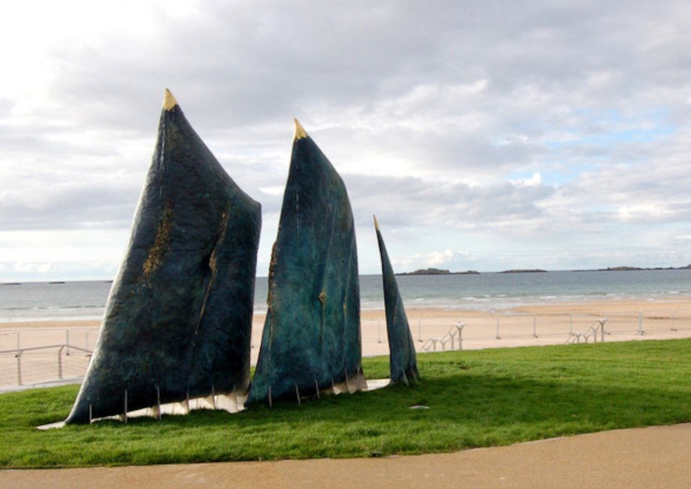 People of the Sea      Fabrication with German sculptor Holger Lönze. 14 ft. bronze sails set in relief against the sea. For Coalisland, Portrush, N. Ireland. (2014)