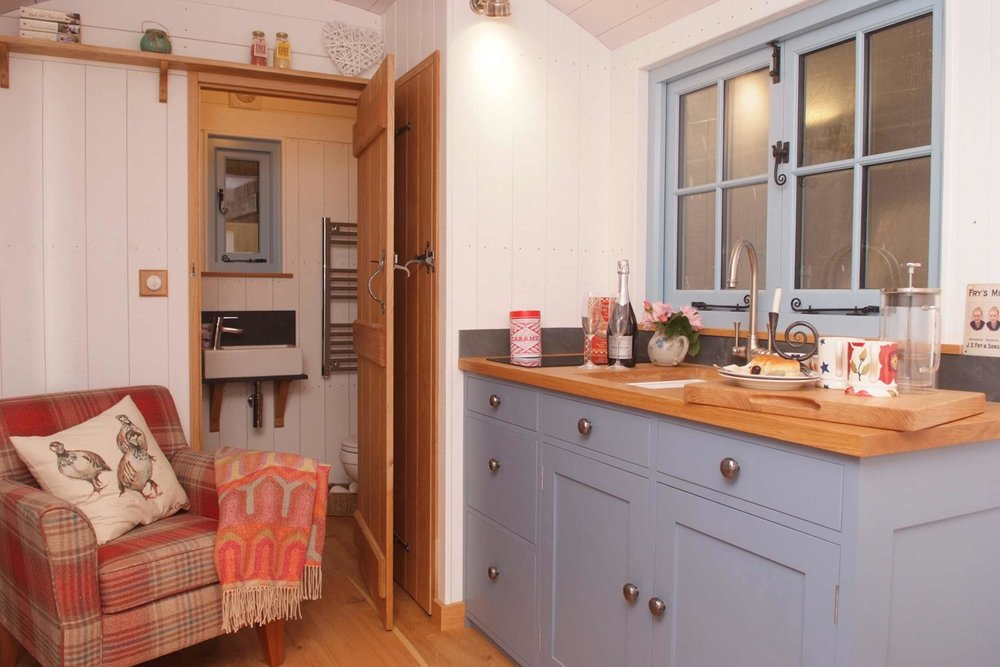 Built in tiny kitchen with ample storage cupboards and perfectly formed bathroom with its own shower