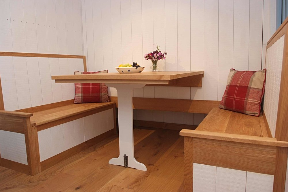 Built in seating with storage under seats and drop down dining table