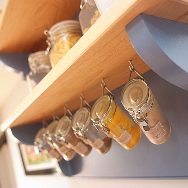 A detail from the maple and painted kitchen - a bespoke spice rack.